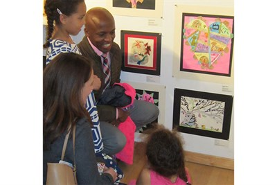 Guests enjoy a Youth Art Month reception