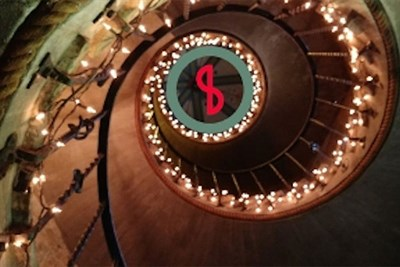 A spiral staircase with the Occasional Symphony logo