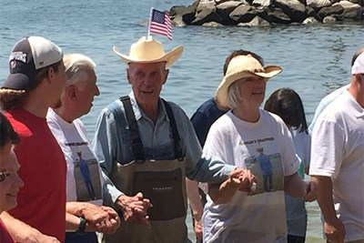 Senator Fowler and others wade into the Patuxent River