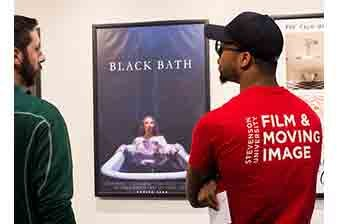 Two men at the film poster exhibit