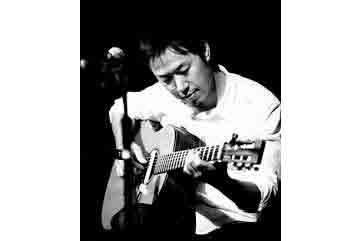 Hiroya playing the guitar