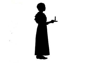 a silhouette of young woman with a candle