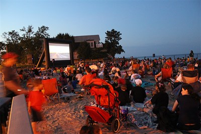 Crowds Enjoying a Movie on the Beach