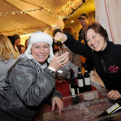 Goosebumps, Grapes & Growlers being enjoyed inside a heated tent