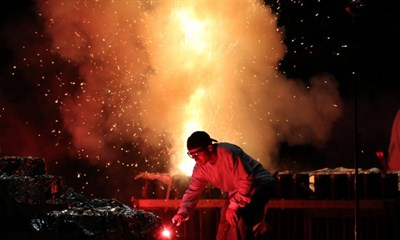 man lighting fireworks