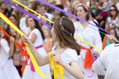 Dancing around the colorful Maypole at May Revels!