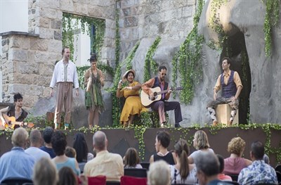 Performers on an outdoor stage.
