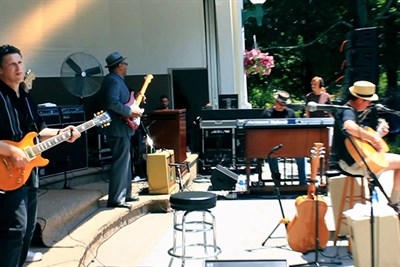 Musicians from Stack O' Blues perform on stage