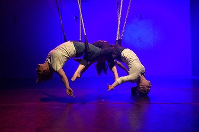 Aerialists perform on dance trapeze