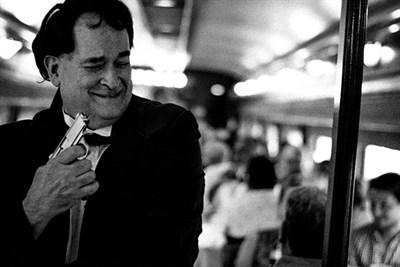 Actor holding a gun in a train car