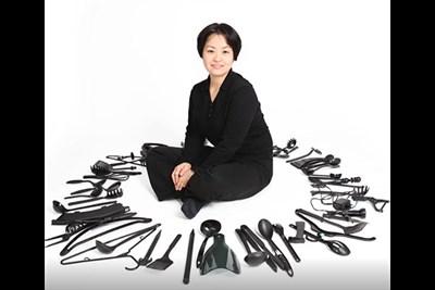 Artist Sayaka Kajita Ganz sits with her materials