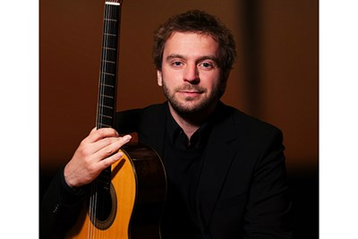 Marcin Dylla with his guitar