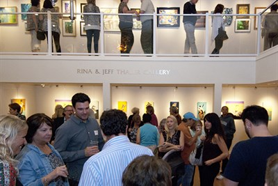 People attending a First Friday Reception