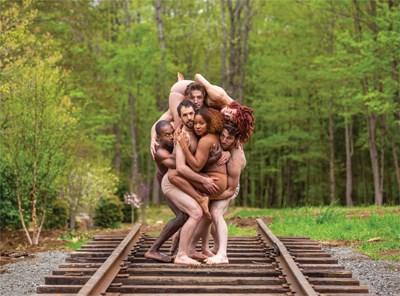 Pilobolus dancers striking a pose