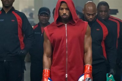 Adonis Creed with his team