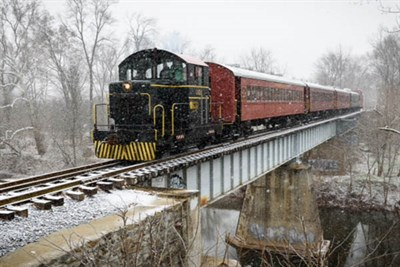 Train in motion crossing a bridge