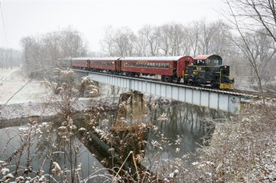 The Santa Train crossing a bridge in light snow