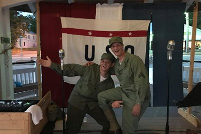"T/5 Vince ""SPAM"" Turner and PFC Vincent ""Bubba"" Turner reenact a WWII radio broadcast."