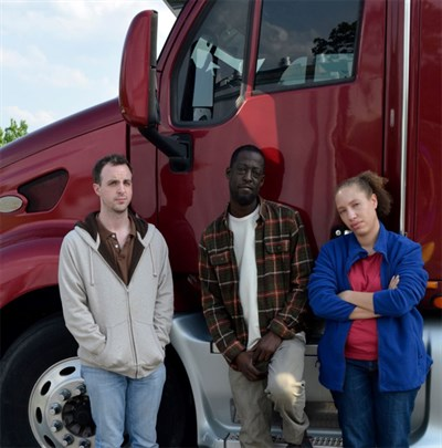 people in front of a truck