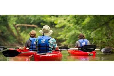 People on a scenic paddle down the Potomac River.