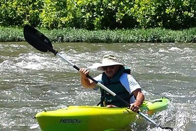 a kayaker enjoying the river