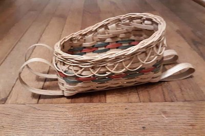 A Sled Basket in holiday colors