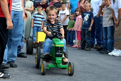boy on toy tractor