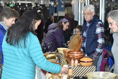 Shoppers explore the Holiday Maker-Mart at the Howard County Arts Council
