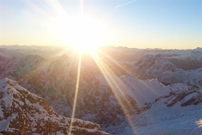 A New Sun Rises Over Mountains