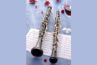 Stilllife with Oboes on a blue background with sheet music