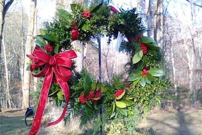 A live wreath with red ribbon