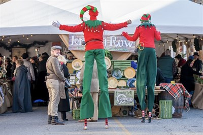 Street performers and a tent filled with handcrafted gifts are part of the Dickens mix.