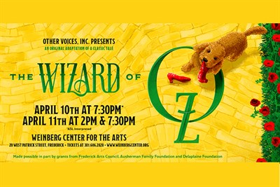 The Wizard of Oz poster with Toto on a yellow brick road