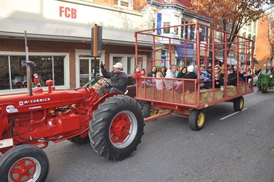 Tractor riding through downtown Frederick