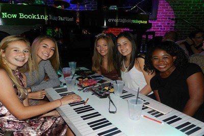 Friends at a Sweet 16th Birthday Celebration at Bobby McKey's