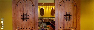 Doors opening to the Latin Grill