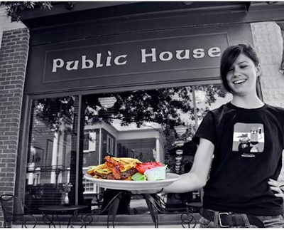 photo of server in froont of Market Street Public House