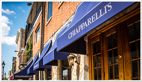 Outside Chiapparelli's Restaurant bright blue awnings welcome all.