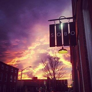 Sobo Café sign at sunset