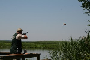 Man shooting a clay pigeon.