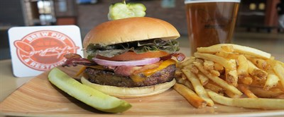 Loaded burger, fries and a pickle
