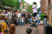 Downtown Frederick crowd enjoys street entertainer