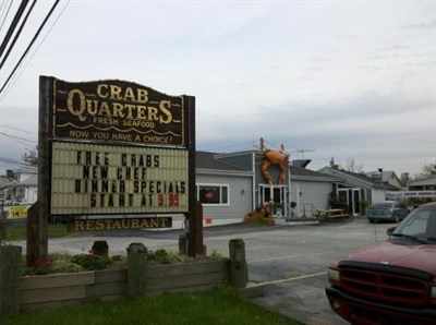 Sign outside of Crab Quarters.
