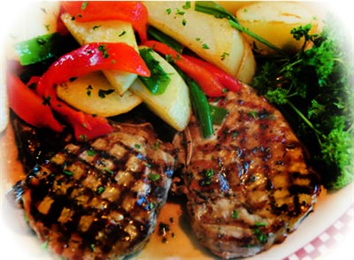 Grilled Pork Chops, mixed vegetables and broccoli -