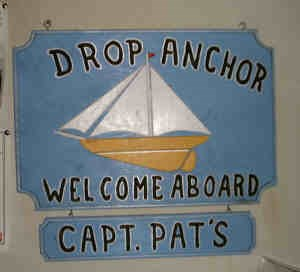 Old-fashioned sign welcomes visitors to Capt. Pat's.