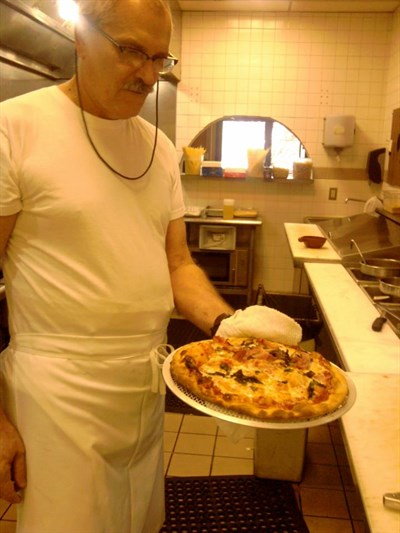 Pizza made at Osteria Alfredo