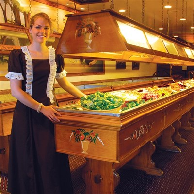 Lady standing by a bountiful buffet
