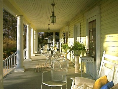 Season at Magnolia Manor front porch