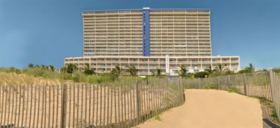 Beach view of Carousel Oceanfront Hotel and Condominiums