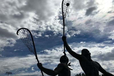 Statue of Native Americans playing LAX